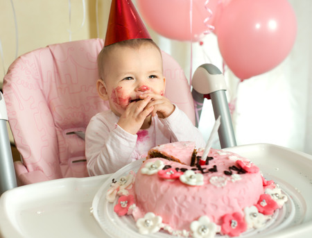 solemnize: one-year-old little girl solemnize birthday, happy laughter, horizontal photo