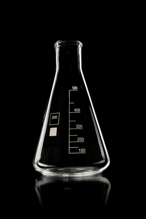 carboy:  laboratory limpid glassware,  vertical photo on black background Stock Photo
