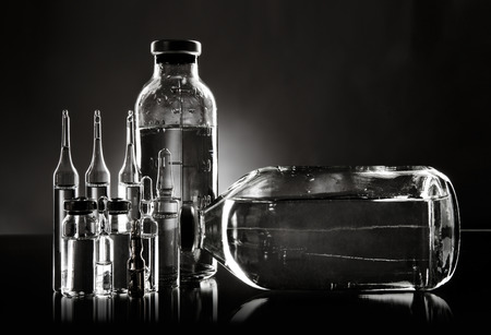glasswork: group object of  liquid medicinal agent in  limpid glassware, black-and-white horizontal photo Stock Photo