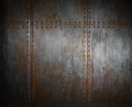 threadbare rusty  steel covering with rivet,  iron background Imagens
