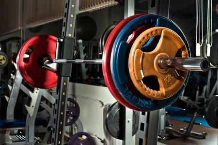 sports hall: weight in dark weight room, horizontal photo Stock Photo