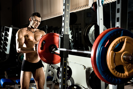 musculation: very power athletic guy ,  execute exercise with  weight