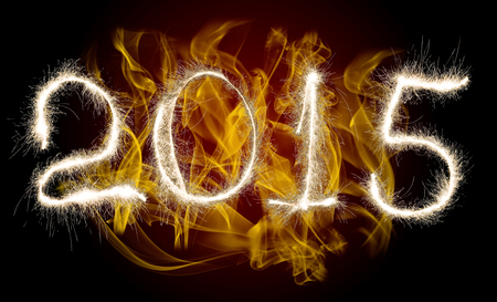 strikingly: Date New Year 2015 of photo sparkle Bengal light on background with flame, collage of figure