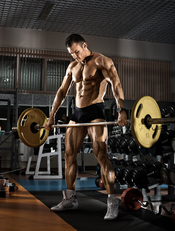 musculation: very power athletic guy bodybuilder,  execute exercise with  weight , in the standing position