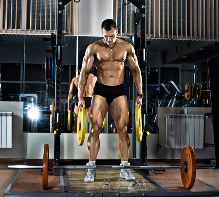 musculation: very brawny guy bodybuilder,  execute exercise with  weight Stock Photo