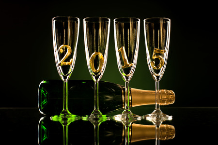 bottle  champagne with four glass goblet and  numeral 2015,  beautiful celebrations  New Year concept photo photo