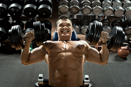 musculation: very brawny guy bodybuilder  Stock Photo