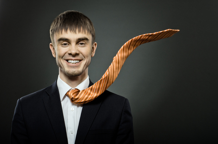 potentiality: portrait the  beautiful  businessman careerist in costume and orange necktie