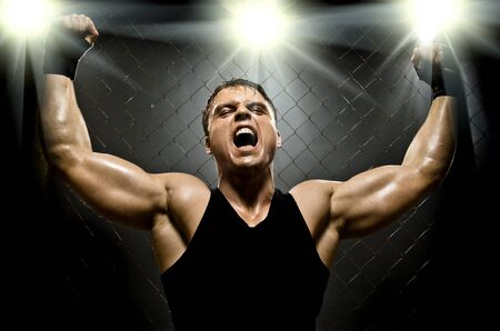 plucky: photo  muscular young  guy street-fighter,  triumphant cries  yell , hard light