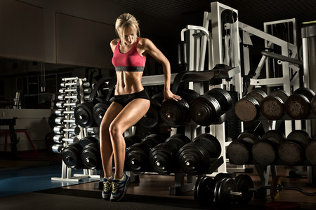 musculation: beautiful girl bodybuilder,  execute exercise with  weight