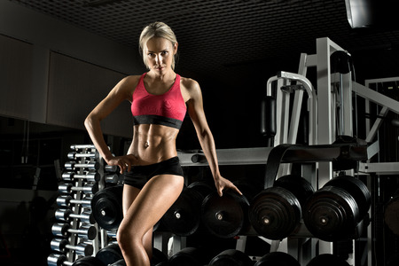 execute: beautiful girl bodybuilder,  execute exercise with  weight
