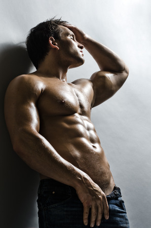 athletic type: The very muscular handsome sexy guy on   grey wall