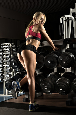execute: Beautiful girl bodybuilder,  execute exercise with  weight Stock Photo
