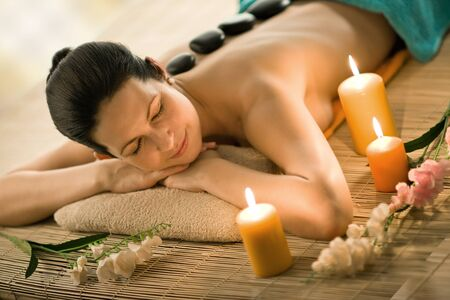 vertebral column: the very  pretty  young woman on spa treatment , horizontal  portrait