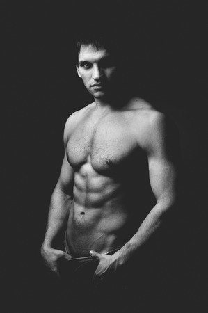 austere: the very muscular handsome sexy guy, black-and-white photo
