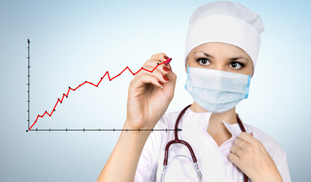 health professional: The woman the doctor holds a marker in a hand, draw diagram