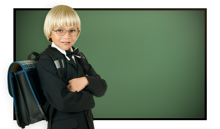 the little children schoolboy stand with green school-board , on white background, isolated photo