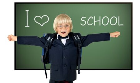 the little children schoolboy gladness stand with green school-board , on white background; isolated photo