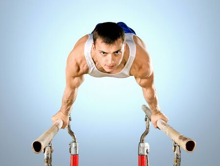brawny: The sportsman the guy, carries out difficult exercise, sports gymnastics