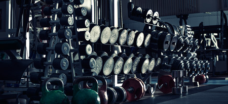 gym room: gym indoor interior with dumbbells;  horizontal panorama photo, blue tone