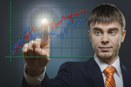 careerist: handsome businessman with diagram, finger point touch, on dark grey background