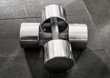 chromeplated: two steel dumbbells, close up black-and-white photo