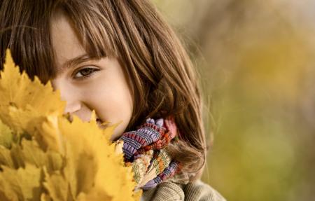 horizontal photo,  beautiful little girl hold many yellow leaf, autumnal portrait photo