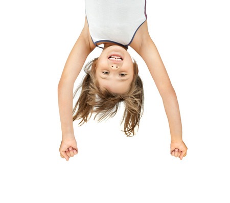 overhang: little girl  overhang head over heels and smile, on white background, isolated