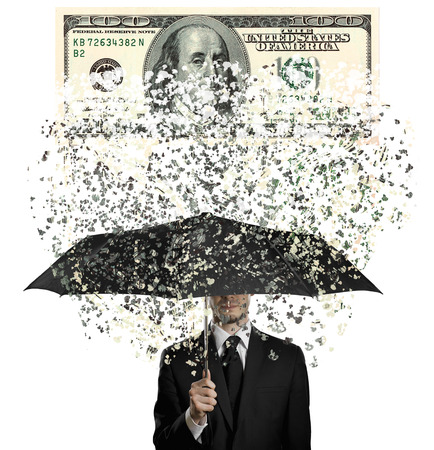 disruption: man in black costume with blak umbrella under rain of  currency note,  concept economics  crisis Stock Photo