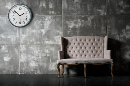 daybed: one soft chair on dark grey background,  horizontal photo Stock Photo