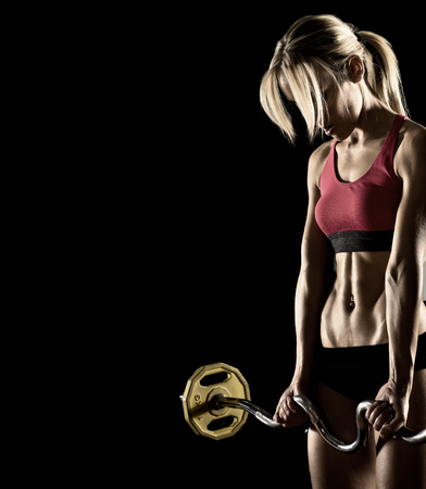 woman black background: young fitness woman, execute exercise with weight, on black background
