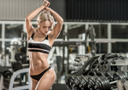 slender woman: young fitness woman in gym, horizontal photo