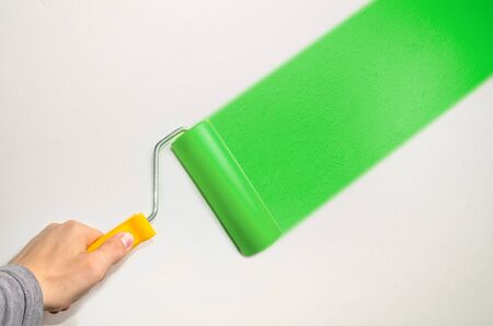 colourer: hand hold roll tool for painting or burnishing , finishing work, close up photo