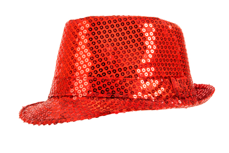 festively: one festively shining red hat, from one side, on white background; isolated