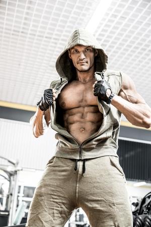 bodybuilder man in gym, vertical photo