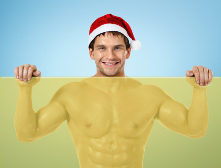 fitness sexy Santa Claus , stand with yellow banner and smile