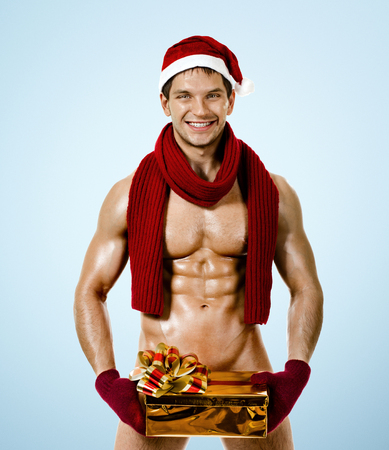 fitnesssexy Santa Claus in red muffler with fancy box , smile, on blue background