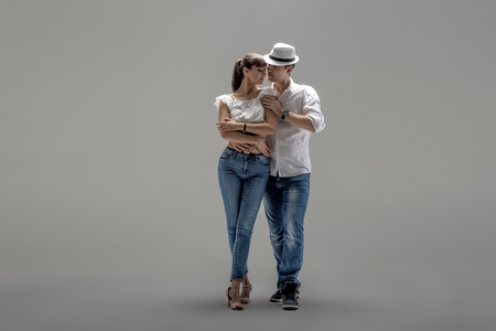 beauty couple dancing social danse ( kizomba or bachata or semba or taraxia) , on grey background Stock Photo - 70224421