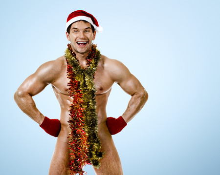 fitness sexy Santa Claus, smile, on blue background photo