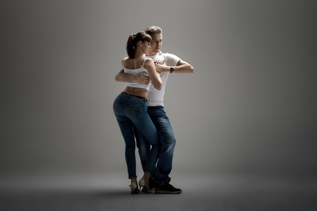 beauty couple dancing social danse ( kizomba or bachata or semba or taraxia) , on grey background Stock Photo - 70224438