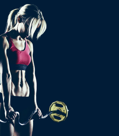 young fitness woman, execute exercise with weight, on black background