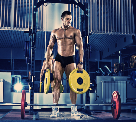 musculation: guy bodybuilder, execute exercise with weight, blue, violet tone