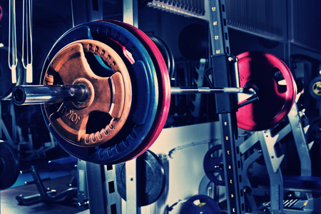 sports hall: weight in dark weight room, horizontal photo, blue; violet tone Stock Photo
