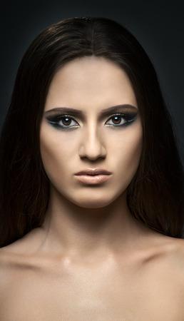 the very pretty woman, symmetry portrait fase , sensual strict gaze photo