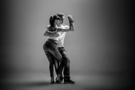 beauty couple dancing social danse ( kizomba or bachata or semba or taraxia) , black-and-white photo Stock Photo
