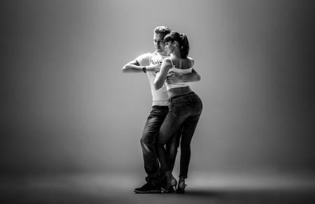 beauty couple dancing social danse ( kizomba or bachata or semba or taraxia) , black-and-white photo Stock Photo