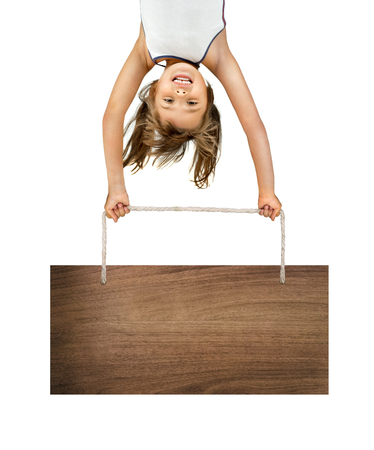 little children girl  stand head over heels hold plate and smile, on white background, isolated