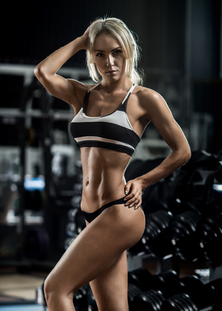 young fitness woman execute exercise in gym, vertical photo Stock Photo
