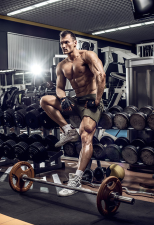 very power guy - bodybuilder rest in gym, vertical photo