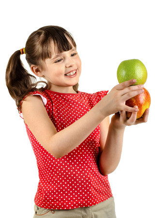 beauty happy little girl, hold two apple, on white background, isolated Stock Photo